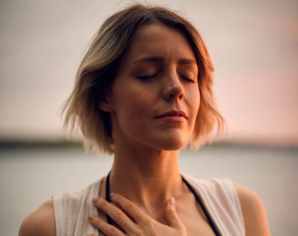 woman meditate hand on heart