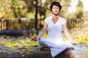 middle aged woman yoga meditation