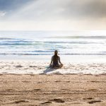 woman meditate beach