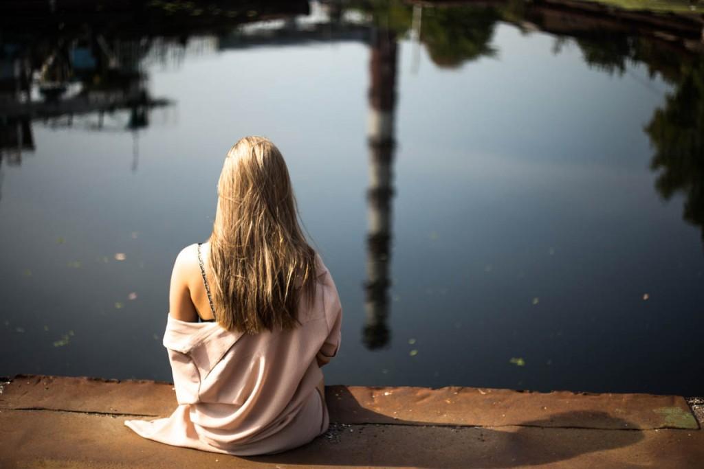 woman meditate lake